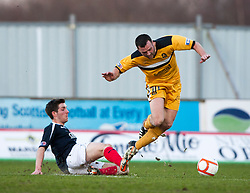 Falkirk's Iain Flannigan tackles Dumbarton's Fleming..Falkirk v Dumbarton, 16/4/2013.