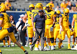 Oct 6, 2018; Morgantown, WV, USA; West Virginia Mountaineers head coach Dana Holgorsen watches his team warm up prior to their game against the Kansas Jayhawks at Mountaineer Field at Milan Puskar Stadium. Mandatory Credit: Ben Queen-USA TODAY Sports