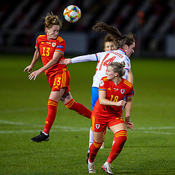 NEWPORT, WALES - Thursday, October 22, 2020: Wales' Rachel Rowe (L) wins a header during the UEFA Women's Euro 2022 England Qualifying Round Group C match between Wales Women and Faroe Islands Women at Rodney Parade. Wales won 4-0. (Pic by David Rawcliffe/Propaganda)