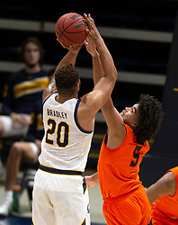 Feb 25, 2021; Berkeley, California, USA; Oregon State Beavers guard Ethan Thompson (5) deflects a shot by California Golden Bears guard Matt Bradley (20) during the second half of an NCAA college basketball game at Haas Pavilion. Mandatory Credit: D. Ross Cameron-USA TODAY Sports
