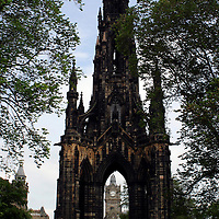 Europe, Great Britain, United Kingdom, Scotland, Edinburgh. The Scott Monument framing the Balmoral Hotel clock tower.