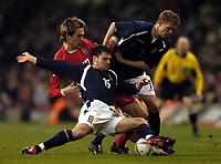 Photo: Richard Lane.<br /> Wales v Scotland. International Friendly. 18/02/2004.<br /> Graeme Murty and Darren Fletcher of Scotland challenge Gareth Taylor of Wales