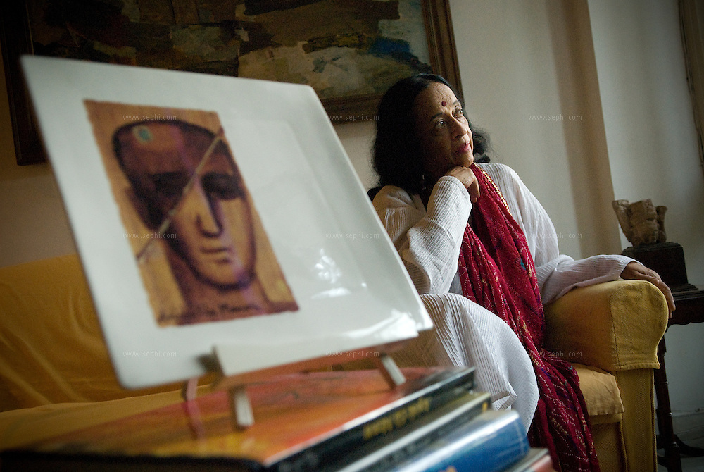 Artist Anjolie Ela Menon and one of her works at  her home in New Delhi, September 2008