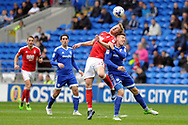 Nottingham's Joseph Worrall (42) challenges Cardiff's Anthony Pilkington (r) for a header. EFL Skybet championship match, Cardiff city v Nottingham Forest at the Cardiff City Stadium in Cardiff, South Wales on Easter Monday 17th April 2017.<br /> pic by Carl Robertson, Andrew Orchard sports photography.