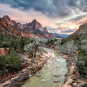 This view of Watchman Peak and the Virgin River is a classic western image. Along with a million other photographers, I have stopped on the bridge in the middle of Zion National Park on every trip I've ever made through the canyon. This one is my personal favorite. Made in deepest, darkest January, the inclination of the sun is low and far to the south, illuminating the ridge with mellow sunset and warming the distant Eagle Crags with a surrounding cape of snow.