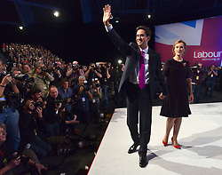 © Licensed to London News Pictures. 02/10/2012. Manchester, UK Ed Miliband on stage with his wife Justine, Labour Party leader finishes making his leaders speech on Day 3 at The Labour Party Conference at Manchester Central today 2nd october 2012. Photo credit : Stephen Simpson/LNP