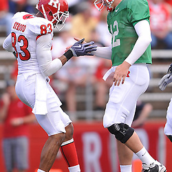 Apr 24, 2010; Piscataway, NJ, USA; White wide receiver Keith Stroud (83) and quarterback Steve Shimko (12) celebrate their touchdown reception and pass during Rutgers Scarlet and White intersquad NCAA football scrimmage at Rutgers Stadium. The Scarlet squad defeated the White, 16-7.