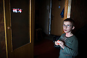 Yaroslav, 10, is playing with a small photo/video-recording drone while inside the provisional home where he resides with his mother Olga, 36, as internally displaced persons. (IDPs) Yeroslav is taking part to the UNICEF-sponsored One Minute Junior project for internally displaced persons (IDPs), carried out by the local NGO 'Ukrainian Frontiers' in the city of Kharkiv, the country's second-largest, in the east. The conflict between Ukrainian army and Russia-backed separatists nearby, in the Donbass region, have left more than 10000 dead since April 2014, including over 1000 since the shaky Minsk II ceasefire came into effect in February 2015. The approximate number of people displaced by the conflict is 1.4 million as of August 2015. Yeroslav's mother, Olga, is also a participant to a different project of 'Ukrainian Frontiers', called 'Self-Employment', first as a beneficiary, and now as a paid hotline coordinator for people seeking jobs and formation courses.