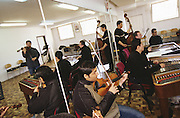 Roma youth learn to play classical music in an orchestra conservatoire. Slovakia.