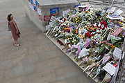 On the first anniversary of the London Bridge and Borough Market terrorist attacks in 2017, flowers and messages are left on the southern end of the the bridge, on 4th June 2018, in London, England.