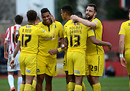 Reuben Reid celebrates scoring second goal during the Sky Bet League 2 match between Cheltenham Town and Plymouth Argyle at Whaddon Road, Cheltenham, England on 28 March 2015. Photo by Alan Franklin.