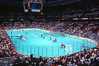July 25, 1998:  Overview of the IIHF In-Line Hockey World Championships  Canada vs the USA at the Arrowhead Pond in Anaheim, CA. .Roller hockey Inline skating rink with blue sport court floor inside an arena with fans filling the seats.