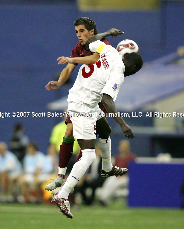 08 July 2007: Portugal's Guedes (behind) and Gambia's Ken Jammeh (5) challenge for the ball. Gambia's Under-20 Men's National Team defeated Portugal's Under-20 Men's National Team 2-1 in a Group C opening round match at Olympix Stadium in Montreal, Quebec, Canada during the FIFA U-20 World Cup Canada 2007 tournament.
