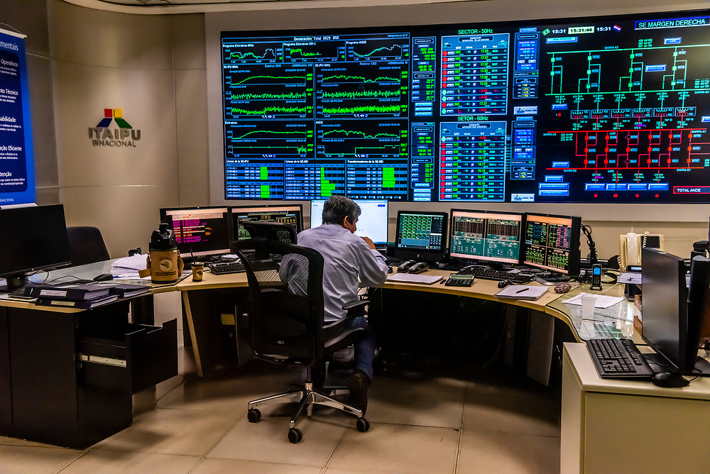 The supervisor room where screens display the transmission of electcitiy to Brazil and Paraguay. Itaipu Hydroelectric Power Plant, on the border of Brazil and Paraguay.<br /> <br /> One of the 20 turbine generators in the powerhouse at the base of the Itaipu Dam. The hydroelectric power plant is capable of generating 14,000 megawatts of electricity. It is on the border of Brazil and Paraguay.