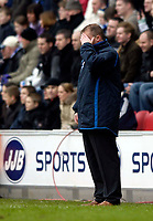 Photo: Jed Wee.<br />Wigan Athletic v Liverpool. The Barclays Premiership. 11/02/2006.<br />Wigan manager Paul Jewell cannot bear to look at his team's performance.