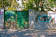Patched gate and oval window.  Lodz Central Poland