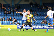 Bury's William Edjenguele competes for the ball with Southend's Barry Corr (r). Skybet football league two match, Bury v Southend Utd at Gigg Lane in Bury, England on Sat 21st Sept 2013. pic by David Richards/Andrew Orchard sports photography