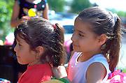 Sisters age 6 and 5 watching Cinco De Mayo Festival.  St Paul  Minnesota USA