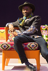 "Bonhams, London, February 29th 2016. Fashion designer and stylist Samson Soboye sits on the chair he created during a photocall for ""Sitting Pretty"", featuring unique, hand painted and upholstered chairs made by 30 celebrities and artists, at Bonhams ahead of their auction in support of a leading AIDS charity, CHIVA Africa.<br /> ©Paul Davey<br /> FOR LICENCING CONTACT: Paul Davey +44 (0) 7966 016 296 paul@pauldaveycreative.co.uk"