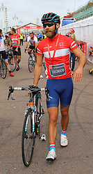James Middleton, brother of, British Heart Foundation ambassador Pippa Middleton, crosses the finish line in Brighton, Sussex, to complete the British Heart Foundation's 40th London to Brighton Bike Ride.