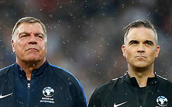 England's Sam Allardyce and Robbie Williams (right) during the UNICEF Soccer Aid match at Old Trafford, Manchester.