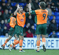 Photo. Aidan Ellis.<br /> Stockport County v Plymouth Argyle.<br /> Nationwide Division 2.<br /> 24/01/2004.<br /> Plymouth's David Frio celebrates his goal with Mickey Evans