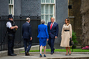 Prime Minister Theresa May  and husband Philip May greet President Donald Trump and First Lady Melania Trump at Downing Street on 4th June 2019 in London, United Kingdom. This is day two of the US Presidents state visit.