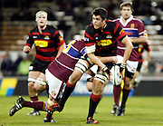 Canterbury player Isaac Ross looks to pass during the Air New Zealand Cup week 4 Ranfurly Shield match between Canterbury and Southland on Friday August 18, 2006 at Jade Stadium in Christchurch, New Zealand. Canterbury won the game 24-7. Photo: Jim Helsel/Photosport