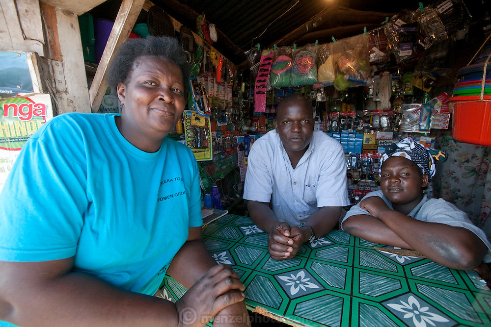 Roseline Amondi (left) a mother of four and microloan recipient with her friends and neighbors near her small café in the Kibera slum, Nairobi, Kenya. (Roseline Amondi is featured in the book What I Eat: Around the World in 80 Diets.) MODEL RELEASED.