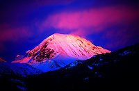 A peak near Whistler Blackcomb ski resort in alpenglow, Whistler, British Columbia, Canada
