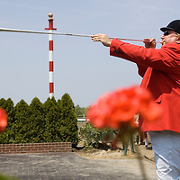(PPAGE1) Oceanport 5/14/2005  Monmouth Park Bugler Frank Hughes of Toms River announces the start of the first race at the track.     Michael J. Treola Staff Photographer....MJT