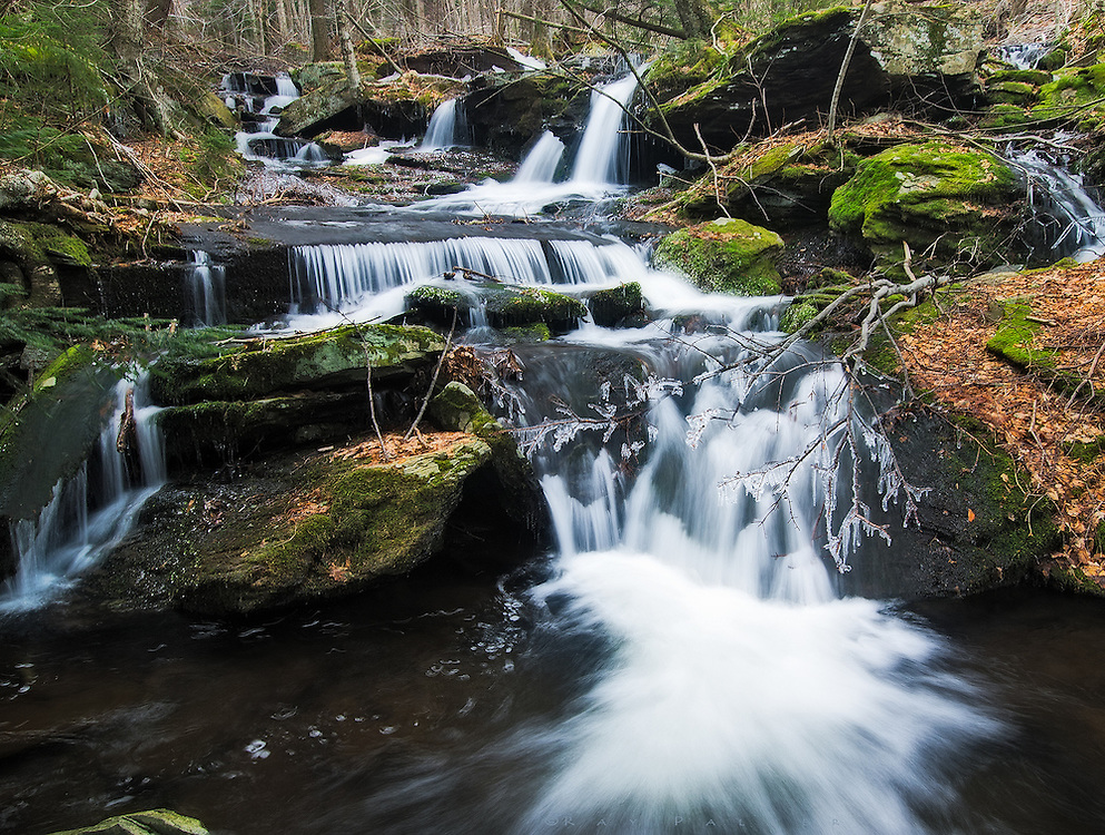 Catskill Mountains, NY.<br /> <br /> The Batavia Kill runs down the slopes of Blackhead/Black Dome Mountain on it's way to the valley.  Little droplets of water splashed and froze into icicles on surfaces close to the water, and adorned the brook with glitter.