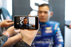 March 1, 2019 - Las Vegas, NV, U.S. - LAS VEGAS, NV - MARCH 01: A reporter records an interview with their smart phone while Kyle Larson (42) Chip Ganassi Racing Chevrolet Camaro ZL1 answers questions from the media in the ThriveHive Digital Center prior to practice and qualifying for the Monster Energy NASCAR Cup Series Pennzoil 400 on March 1, 2019, at Las Vegas Motor Speedway in Las Vegas, NV. (Photo by Joe Buglewicz/Icon Sportswire) (Credit Image: © Joe Buglewicz/Icon SMI via ZUMA Press)