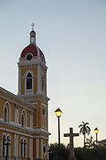 View of the bell tower of Our Lady of the Assumption Cathedral or Granada Cathedral under a clear sky at sunset, Granada, Nicaragua