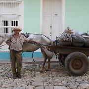 A local Cuban man selling coal on the streets of Trinidad, Cuba.