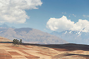 View of agricultural land and Chic?n's mountain ranges in the Sacred Valley of the Incas, Cusco Region, Peru, South America