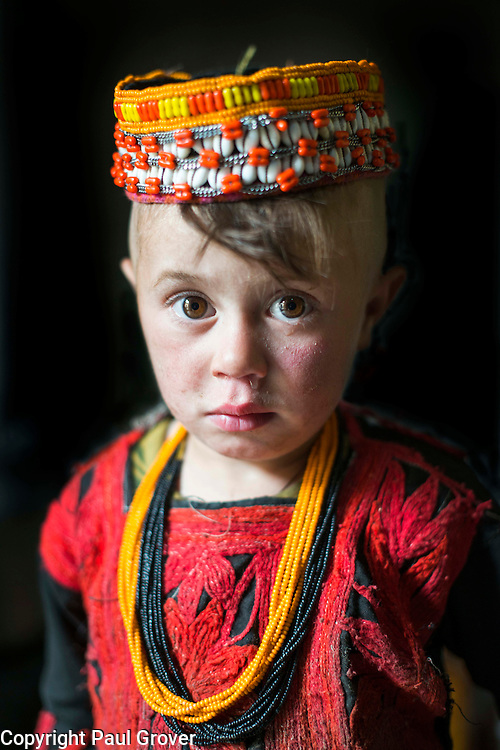 Mcc00Mcc46089.DT Features. Bumburet, Chitral District,Pakistan.Pic Shows A young Kalash girl in the Kalash village in the valley of Bumburet wearing some traditional clothing