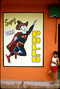 """Super Chicken"" advertisement on a restaurant wall in Campeche, Mexico. (Supporting image from the project Hungry Planet: What the World Eats)"
