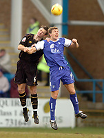 Picture: Henry Browne.<br /> Date: 26/02/2005.<br /> Gillingham v Wigan Athletic Coca Cola Championship.<br /> Matchwinner Darius Henderson of Gills goes up for a header with Wigan's Ian Breckin.