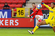 GOAL - 1-0. Charlton Athletic forward Conor Washington (14) shoots and scores a goal during the EFL Sky Bet League 1 match between Charlton Athletic and AFC Wimbledon at The Valley, London, England on 12 December 2020.