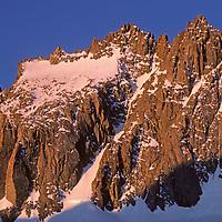 Mounts North Palisade (14,242') and Starlight Peak tower above Palisade Glacier in John Muir Wilderness, Sierra Nevada, California.