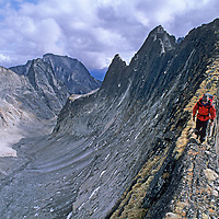 A mountaineer on a narrow arete in the Cirque of the Unclimbables, Northwest Territories,Canada.