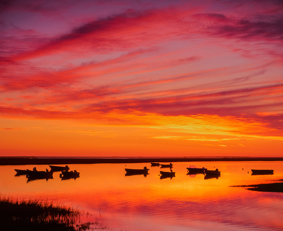 Nauset Marsh at dawn, small boats moored in silhouette, Cape Cod National Seashore, magentas & yellows, Eastham, MA
