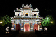Architecture of a prosperous ornamentated doorway at night in Hue Imperial City, Vietnam, Southeast Asia