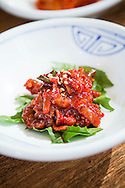 Squid in chili sauce, served as a side dish to bibimbap. Seoul, South Korea