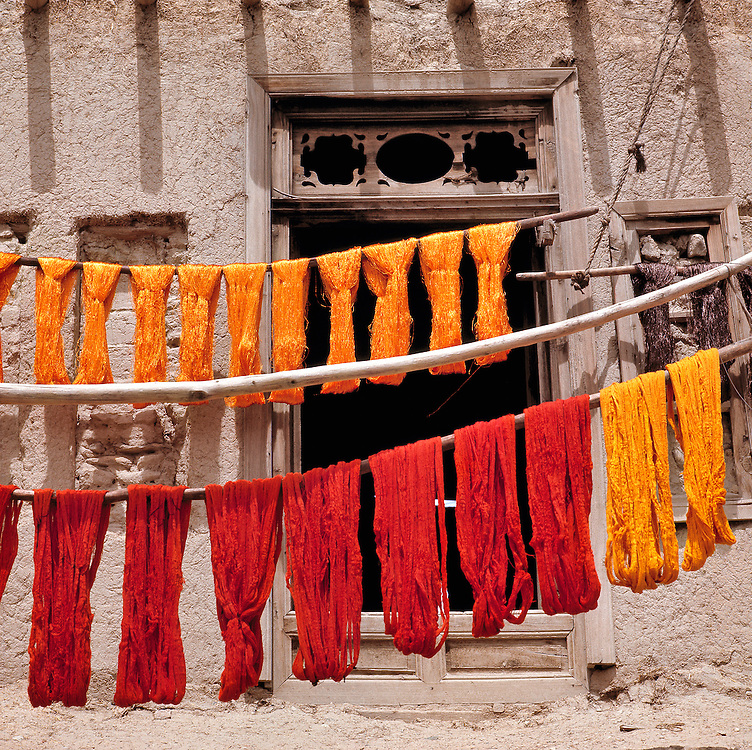 Brightly-colored wool, recently dyed, is hung to dry in Ghazni, Afghanistan.