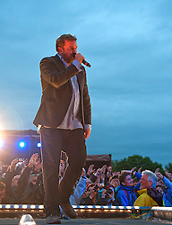 © Licensed to London News Pictures. 23/06/2012. Cheshire,UK. Guy Garvey lead singer with the group Elbow performing  at the Jodrell Bank live music festival : Rob Leyland/LNP