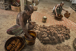 October 13, 2017 - Indian potters color earthen lamps in preparation for Diwali, some 45 km away from Kolkata. Diwali is the Hindu festival of lights which is celebrated on a large scale all over the country. (Credit Image: © Tumpa Mondal/Xinhua via ZUMA Wire)