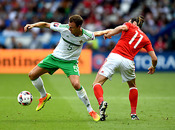 Gareth Bale of Wales battles for the ball with, Jonny Evans of Northern Ireland  - Mandatory by-line: Joe Meredith/JMP - 25/06/2016 - FOOTBALL - Parc des Princes - Paris, France - Wales v Northern Ireland - UEFA European Championship Round of 16