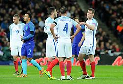 James Milner of England (c) speaks with Danny Drinkwater of England and Adam Lallana of England   - Mandatory by-line: Dougie Allward/JMP - 29/03/2016 - FOOTBALL - Wembley Stadium - London, United Kingdom - England v Netherlands - International Friendly